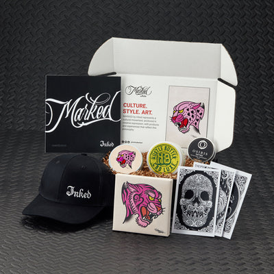 Marked by Inked Megan Massacre Edition. Tattoo inspired art and merchandise, tattoo skincare, organic health and wellness, bonus products and more. Featured artist Megan Massacre