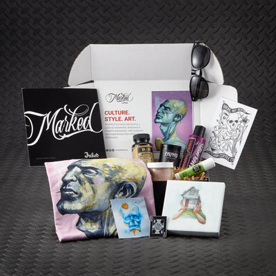 Marked by Inked Express Yourself Edition. Tattoo inspired art and merchandise, tattoo skincare, organic health and wellness, bonus products and more. Featured artist DJ Tambe