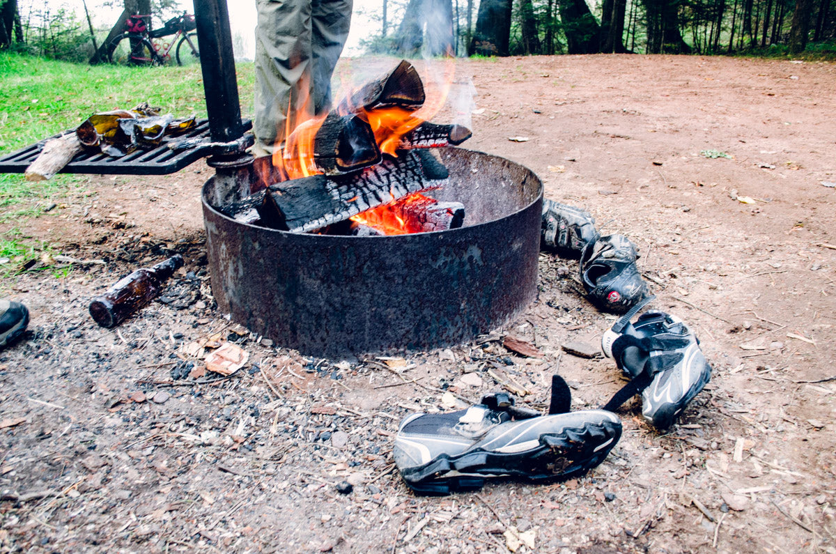 Drying our riding shoes around the campfire at East Twin Lake