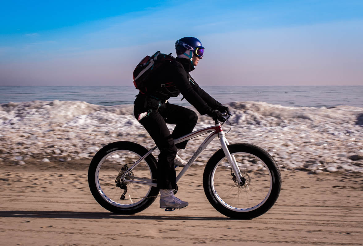 Rolling the sandy beach on a Framed fat bike rented at Fyxation