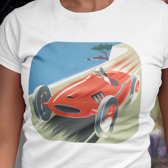 Woman's t-shirt with an image of a man driving a red convertible race car on a high scenic road.