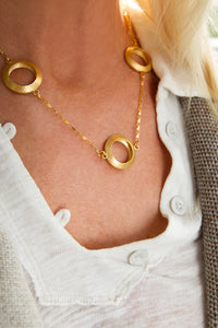 Model wearing Pareure 360º Series Large 18k Yellow Gold Vermeil Trio Necklace