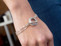 Pareure 360º Series Sterling Silver Multi-strand Toggle Bracelet worn on model's wrist