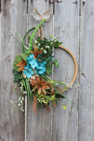hoop wreath with turquoise and brown flowers