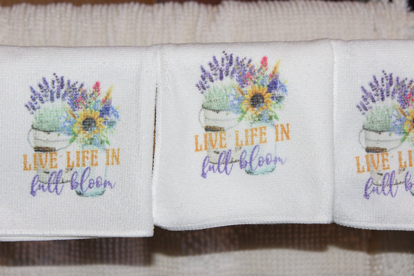 Live Life in Full Bloom Wash Cloths with vintage containers and flowers.