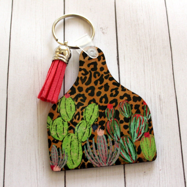 Cow Tag Shaped Key chain with Leopard print  and cactus graphics and pink tassel