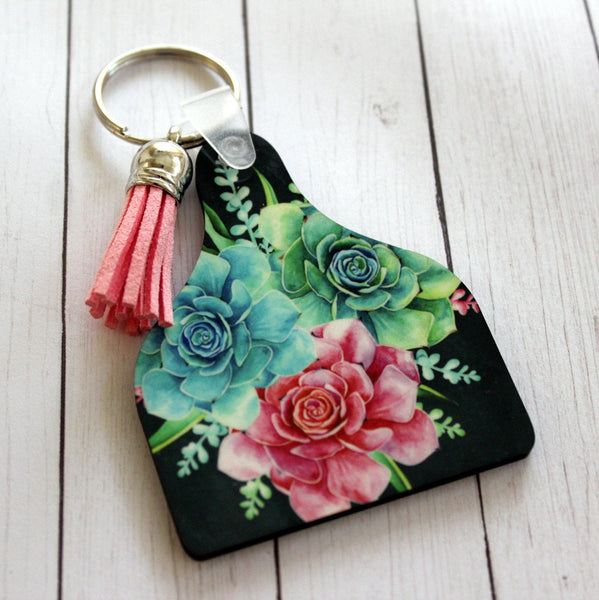 Cow Tag Shaped Key chain with Succulent floral graphics and tassel