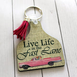 Live Life in the Fast lane Cow Tag Key Chain with Pink Convertible Car