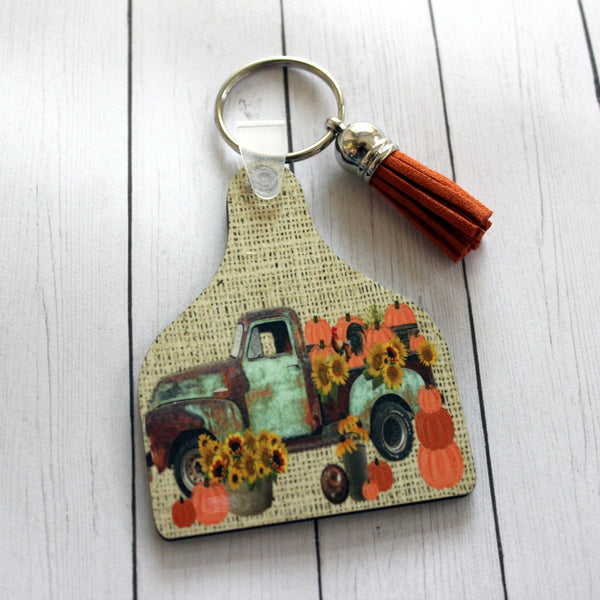 Rusty Truck with Pumpkins, sunflowers, and rooster on Cow Tag Key Chain with tassel