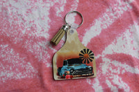 Cow Tag Shaped Key Chain with Windmill, Vintage Truck, Sunrise, and Flowers