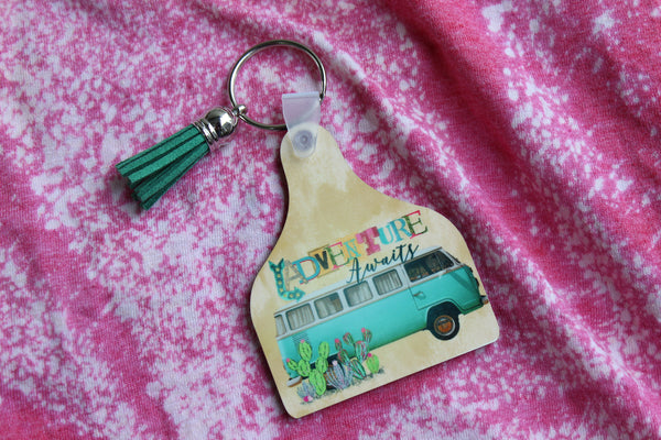 Adventure Awaits Cow Tag Shaped Key Chain with Vintage Bus and Cactus Road Trip Vibes