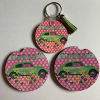 Green bug with pink polka dots and wildflowers car accessory set