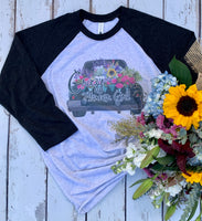 Crazy Flower Girl Graphic T shirt with truck load of spring flowers on a black baseball style tee