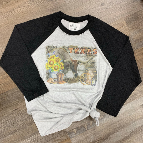 Texas themed tee with Longhorn, boots, hat, wagon wheel, sunflowers