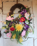 Cheerful Spring Grapevine Wreath with Wooden Birdhouse