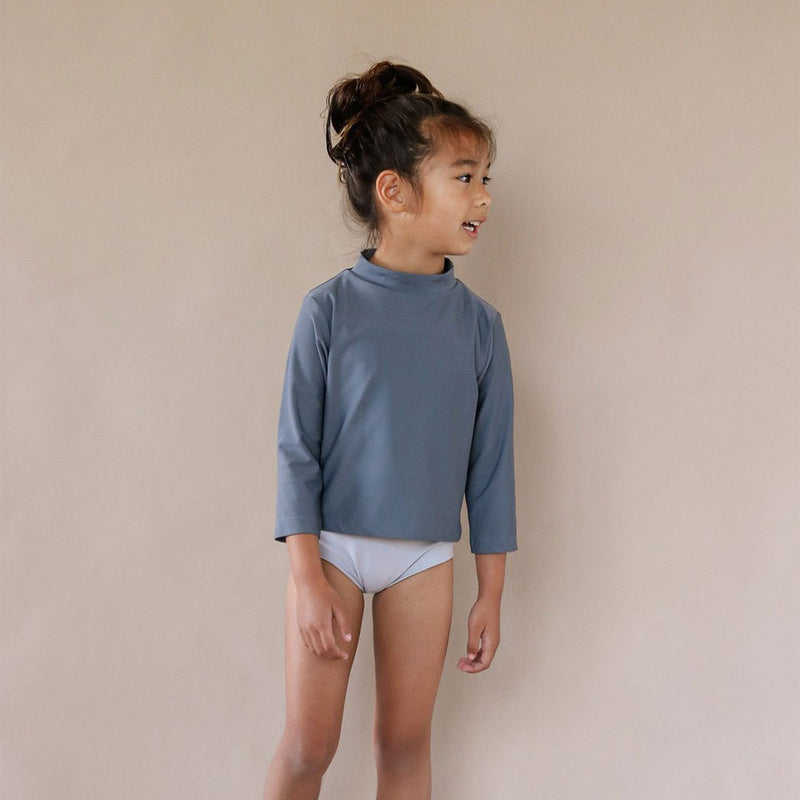 Girl wearing Nella rash shirt by Ina Swim