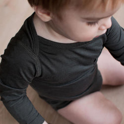 Baby wearing a bodysuit made from bamboo