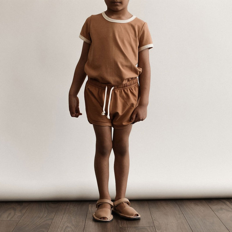Boy wearing Sem Label t-shirt and shorts