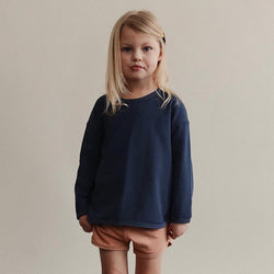 Girl wearing sem label track sweater