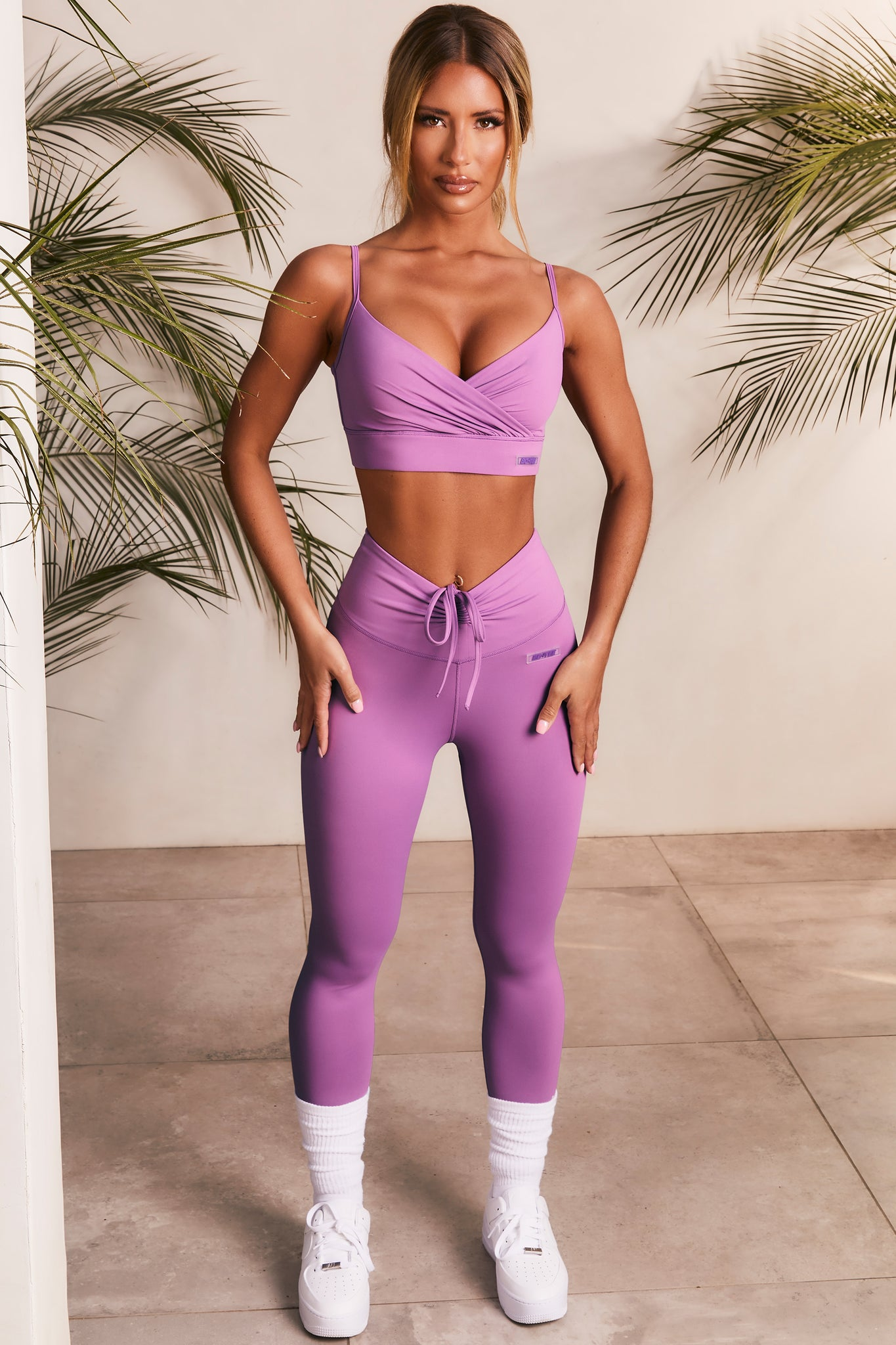 Slinky leggings in purple with V shaped high waist and tie front. Image 1 of 6
