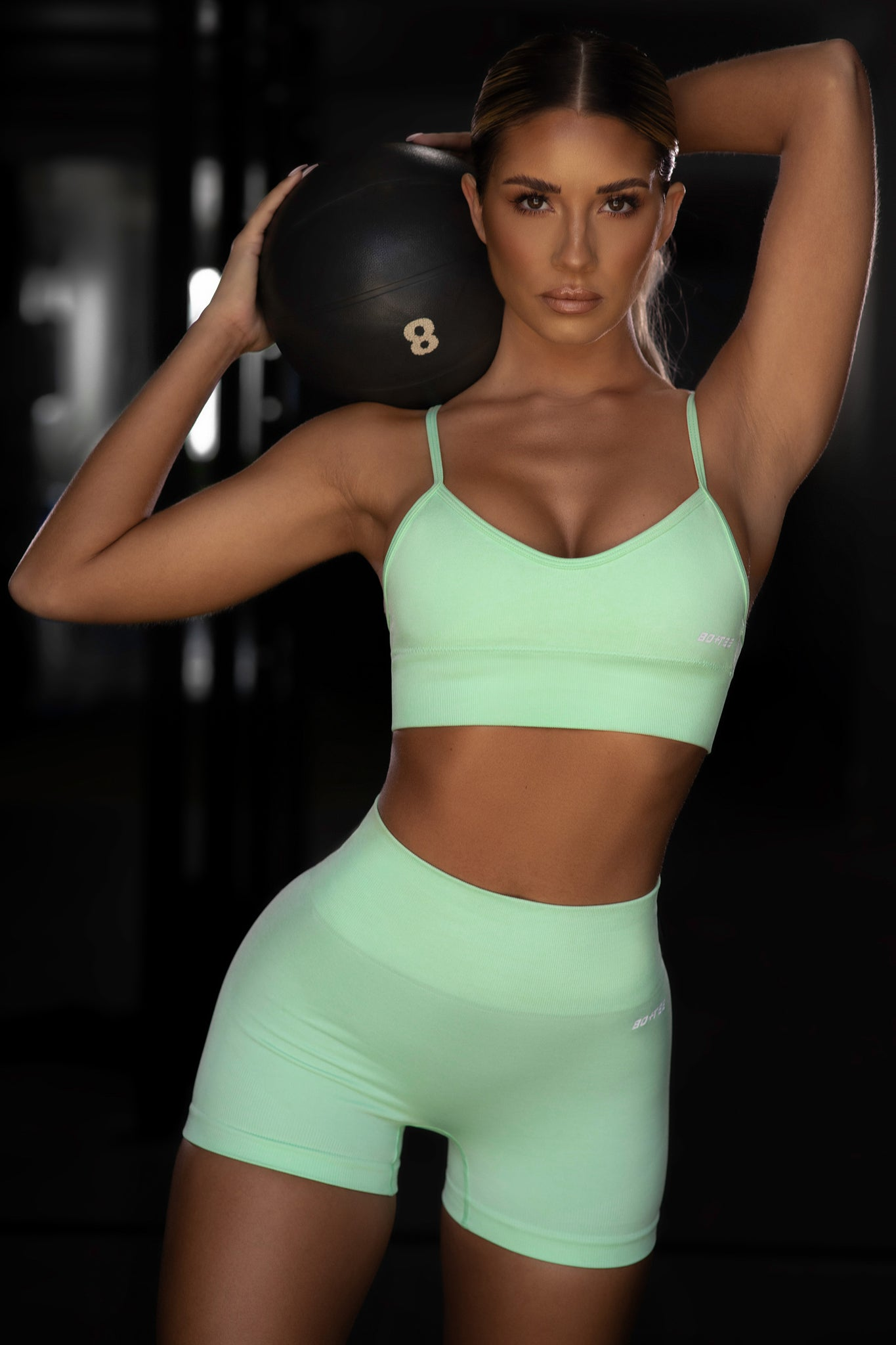 Plain bright green seamless high waisted mini gym shorts. Image 1 of 6.