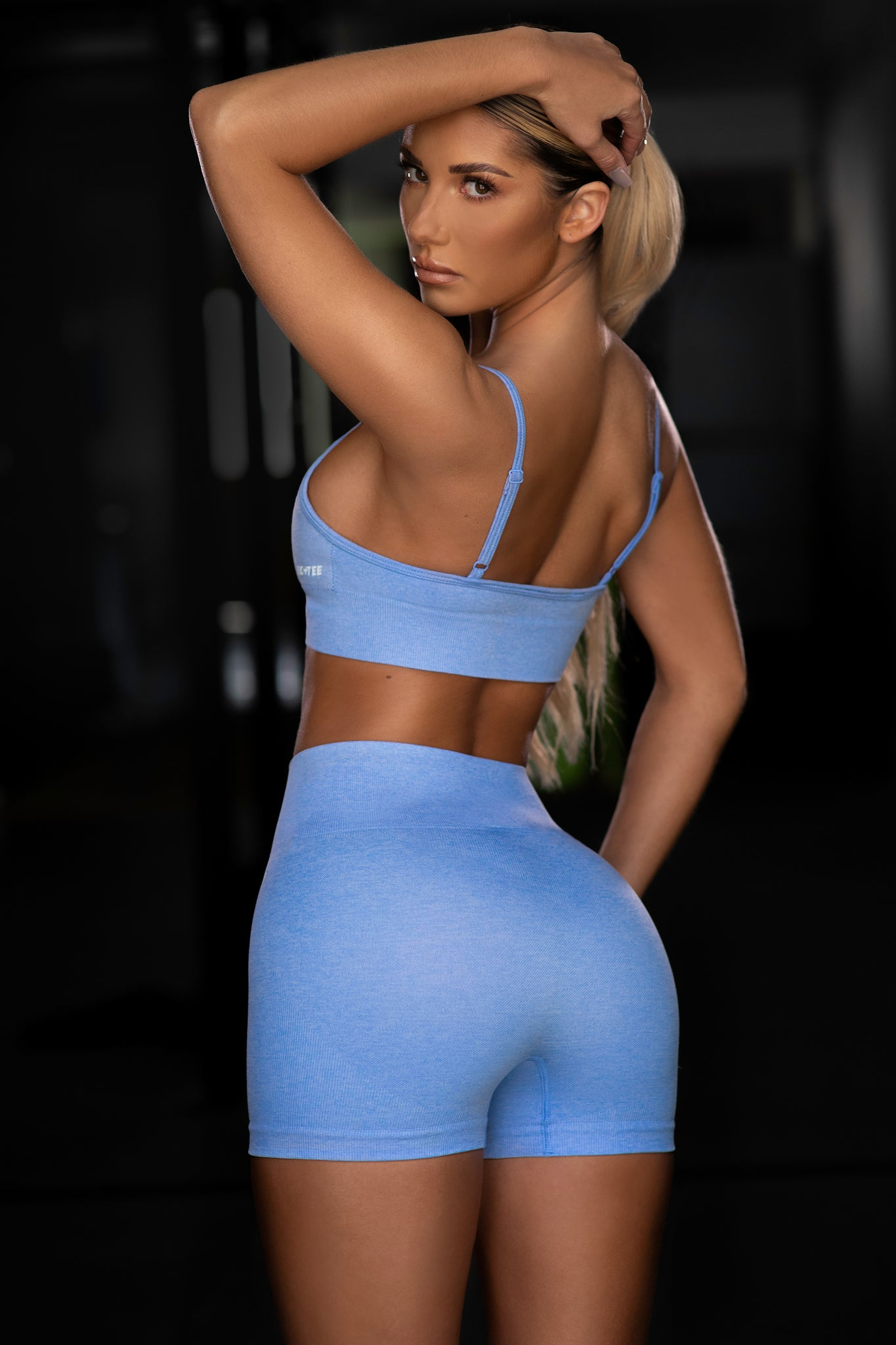 Plain blue seamless high waisted mini gym shorts. Image 3 of 6.
