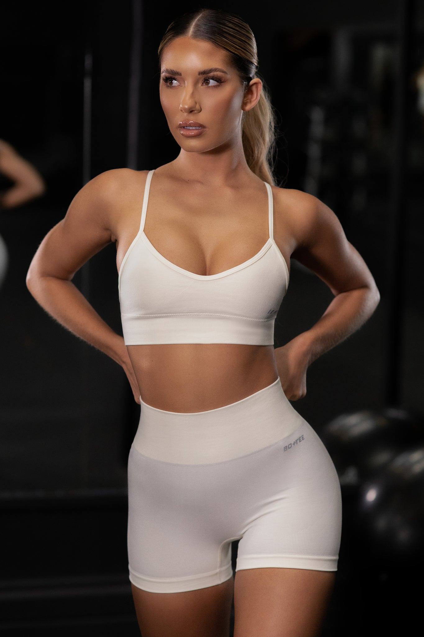 Plain cream V neck sports bra with ribbed underband and thin adjustable straps. Image 5 of 6.