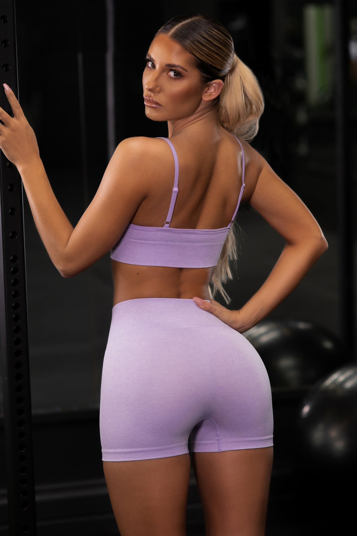 Plain lilac seamless high waisted mini gym shorts. Image 3 of 6.