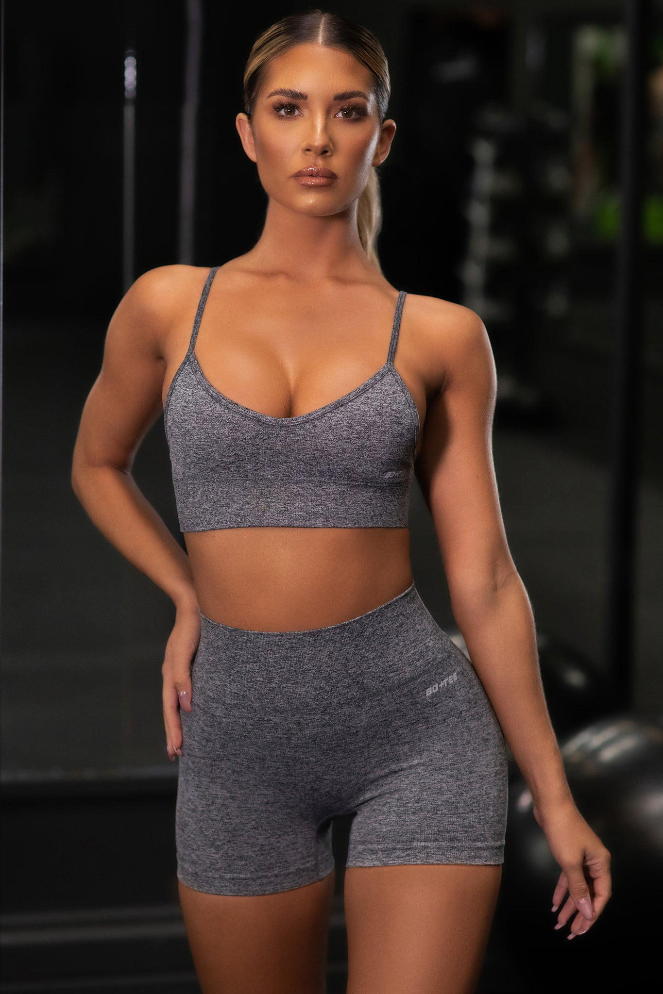 Plain black marl V neck sports bra with ribbed underband and thin adjustable straps. Image 5 of 6.