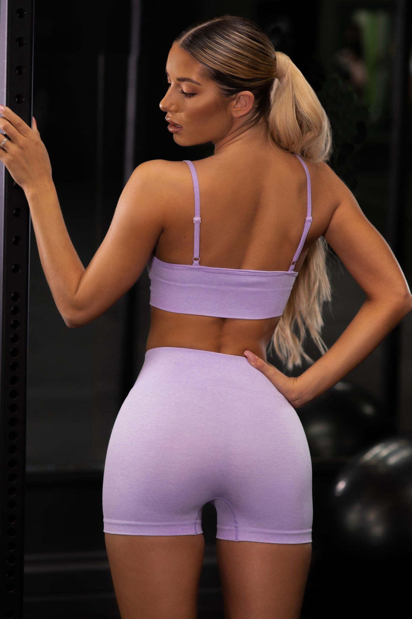 Plain lilac V neck sports bra with ribbed underband and thin adjustable straps. Image 3 of 6.