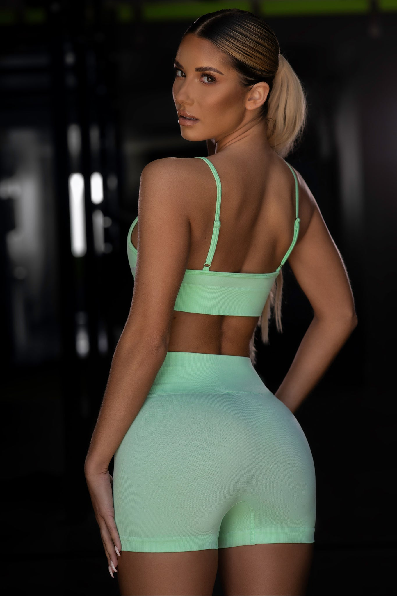 Plain bright green seamless high waisted mini gym shorts. Image 3 of 6.