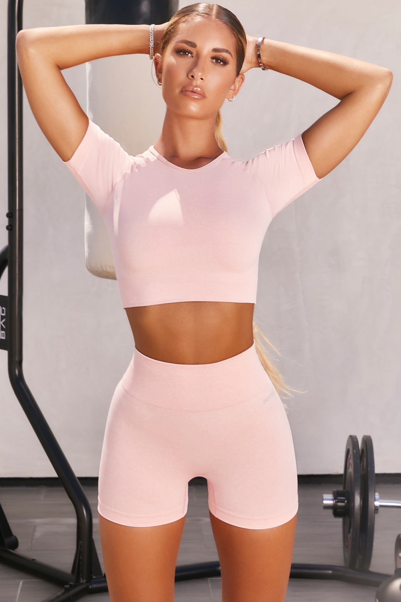 Plain blush pink seamless high waisted mini gym shorts. Image 1 of 6.