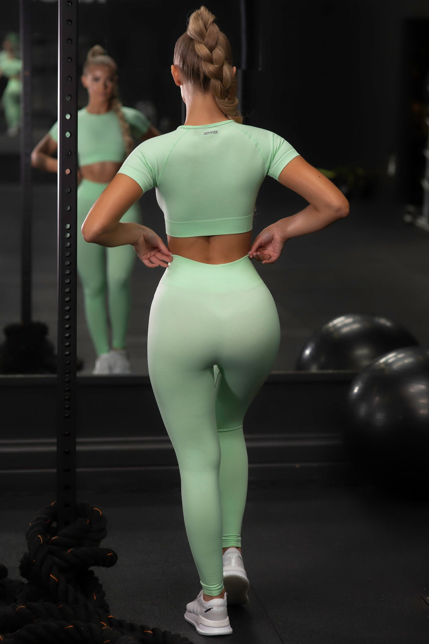 Plain bright green seamless high waisted full length gym leggings. Image 3 of 6.