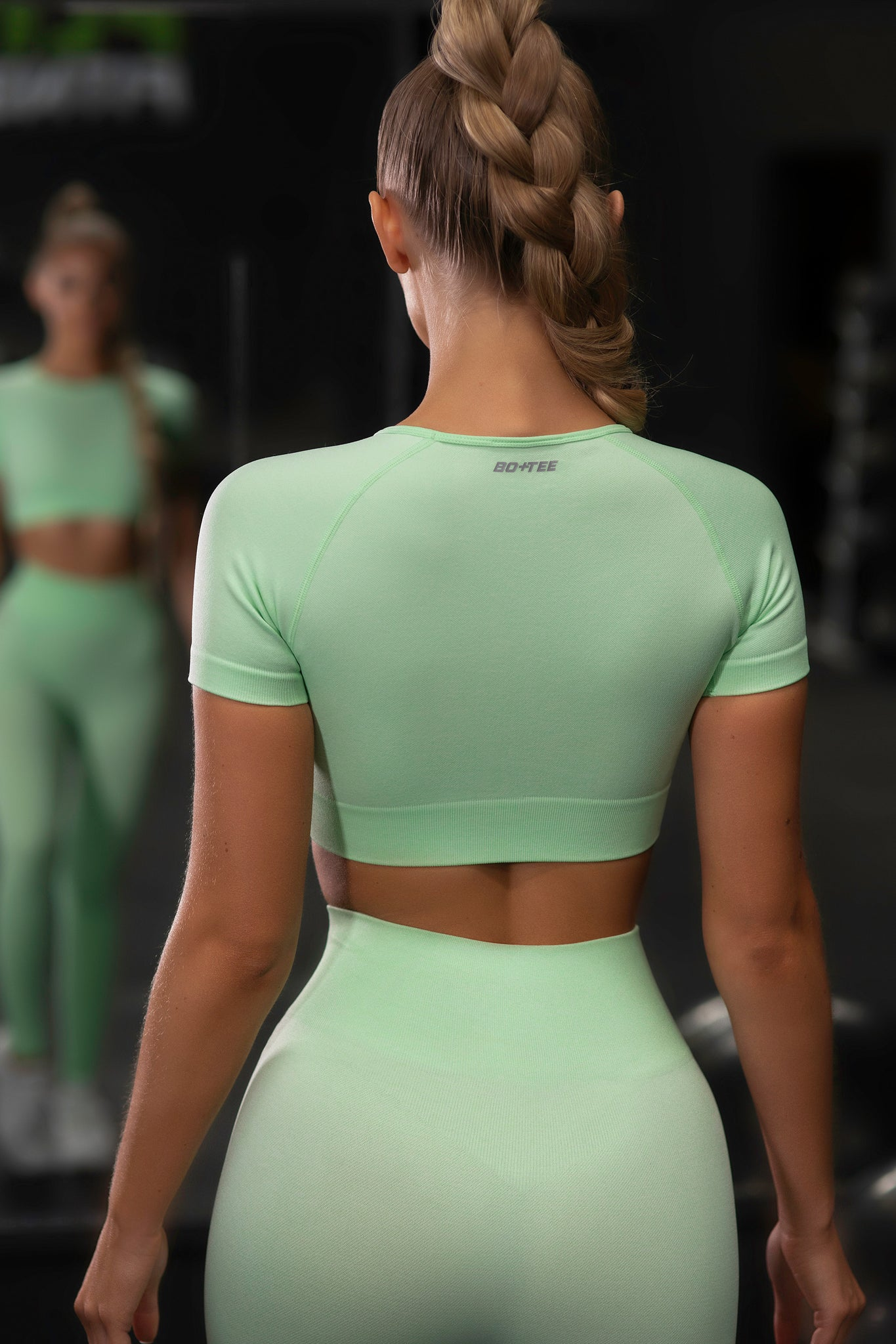 Plain bright green seamless short sleeve crop top with ribbed underband and round neck. Image 3 of 6.