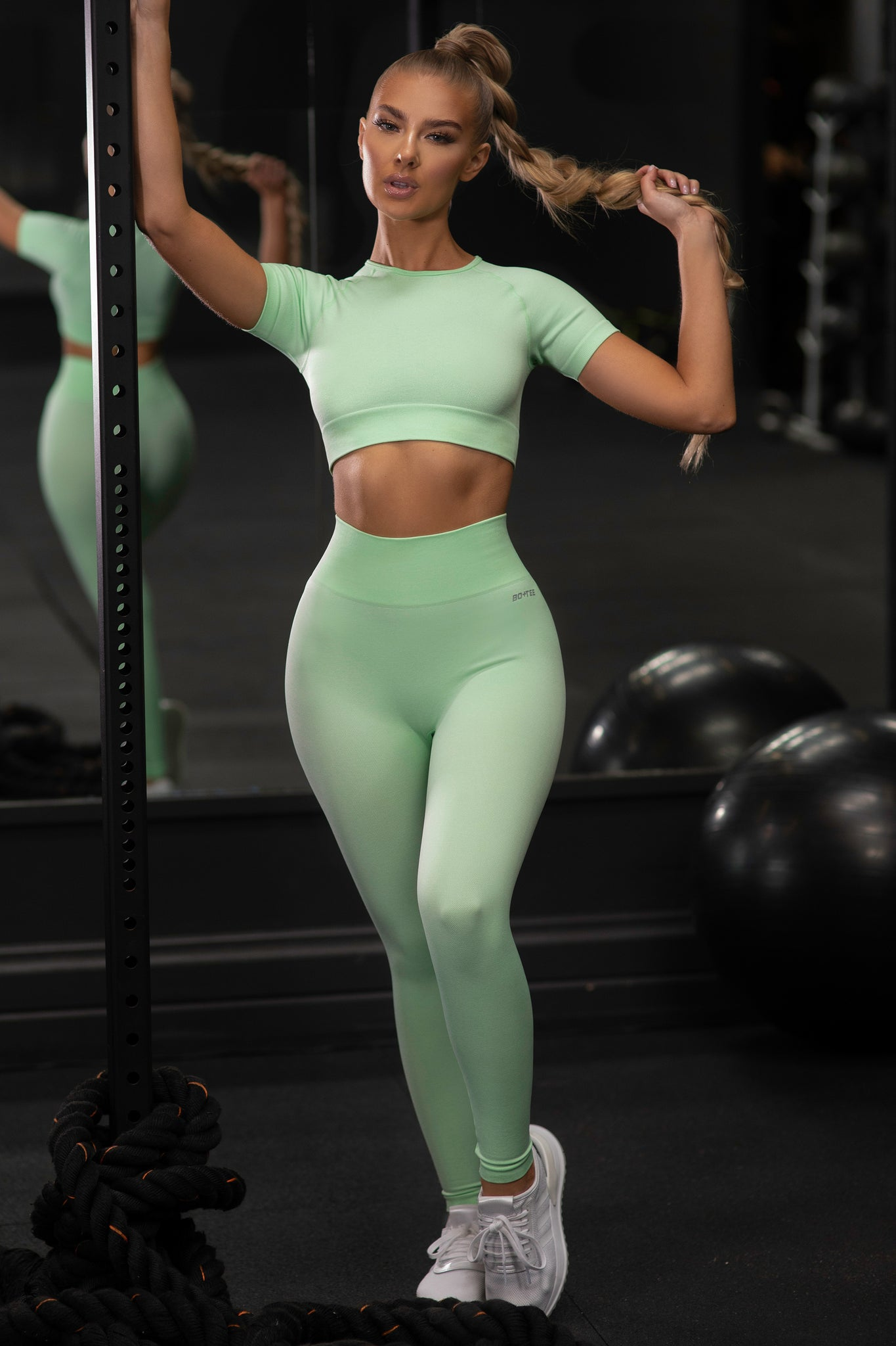 Plain bright green seamless high waisted full length gym leggings. Image 1 of 6.