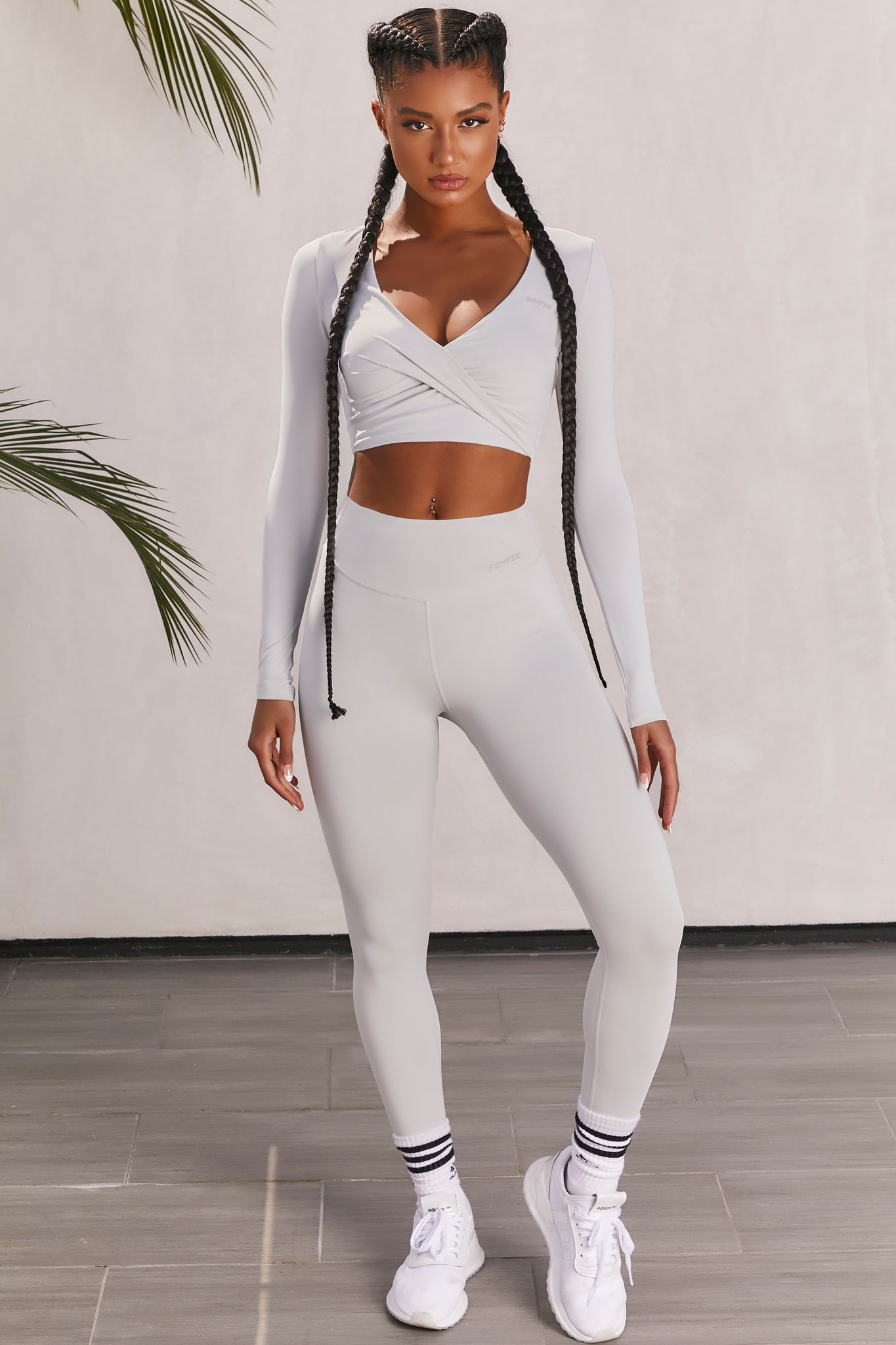 Plain grey slinky high waisted full length gym leggings with rear ruched seam. Image 1 of 6.