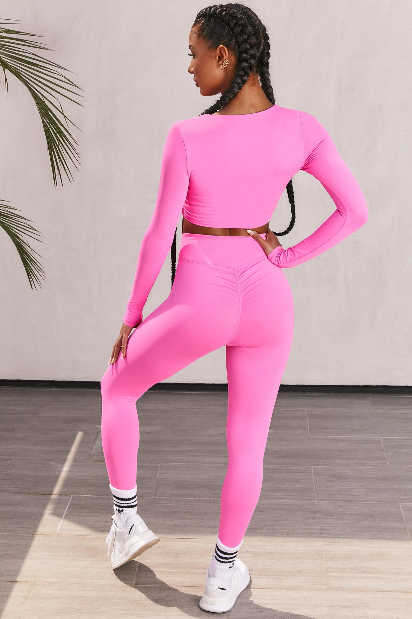 Plain pink slinky long sleeve crop top with plunge neckline and wrap front. Image of 3 of 6.