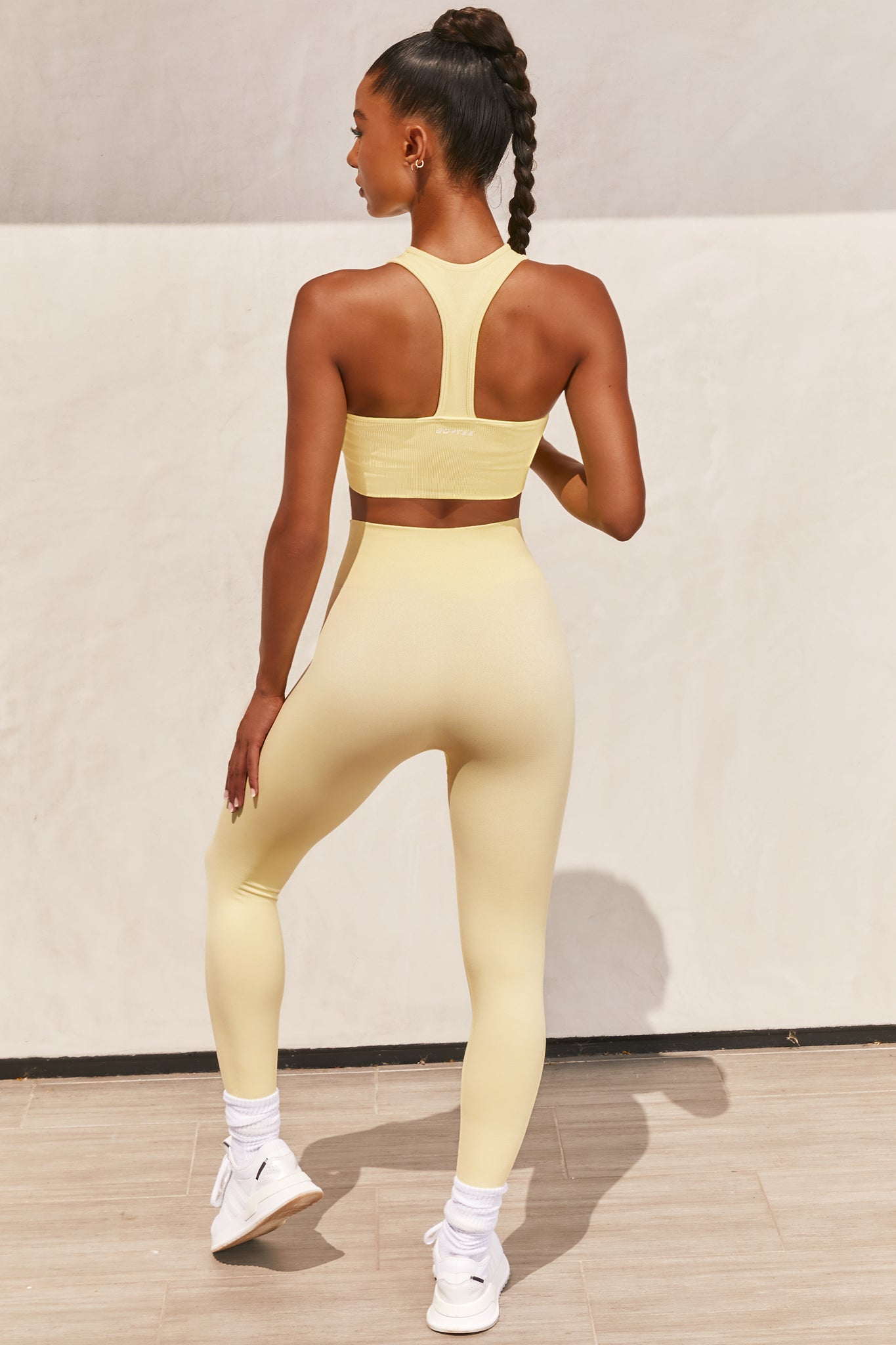 Plain lemon high neck sleeveless crop top with ribbed underband and racer back. Image 3 of 6.