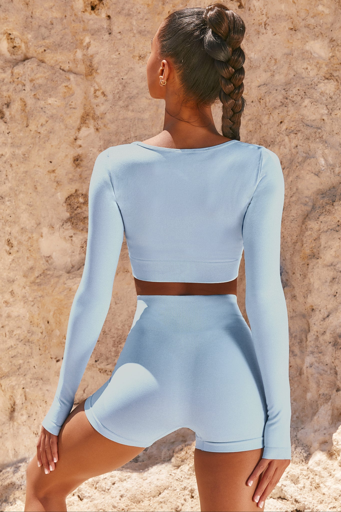 Plain light blue seamless high waisted mini length bodycon gym shorts. Image 3 of 6.