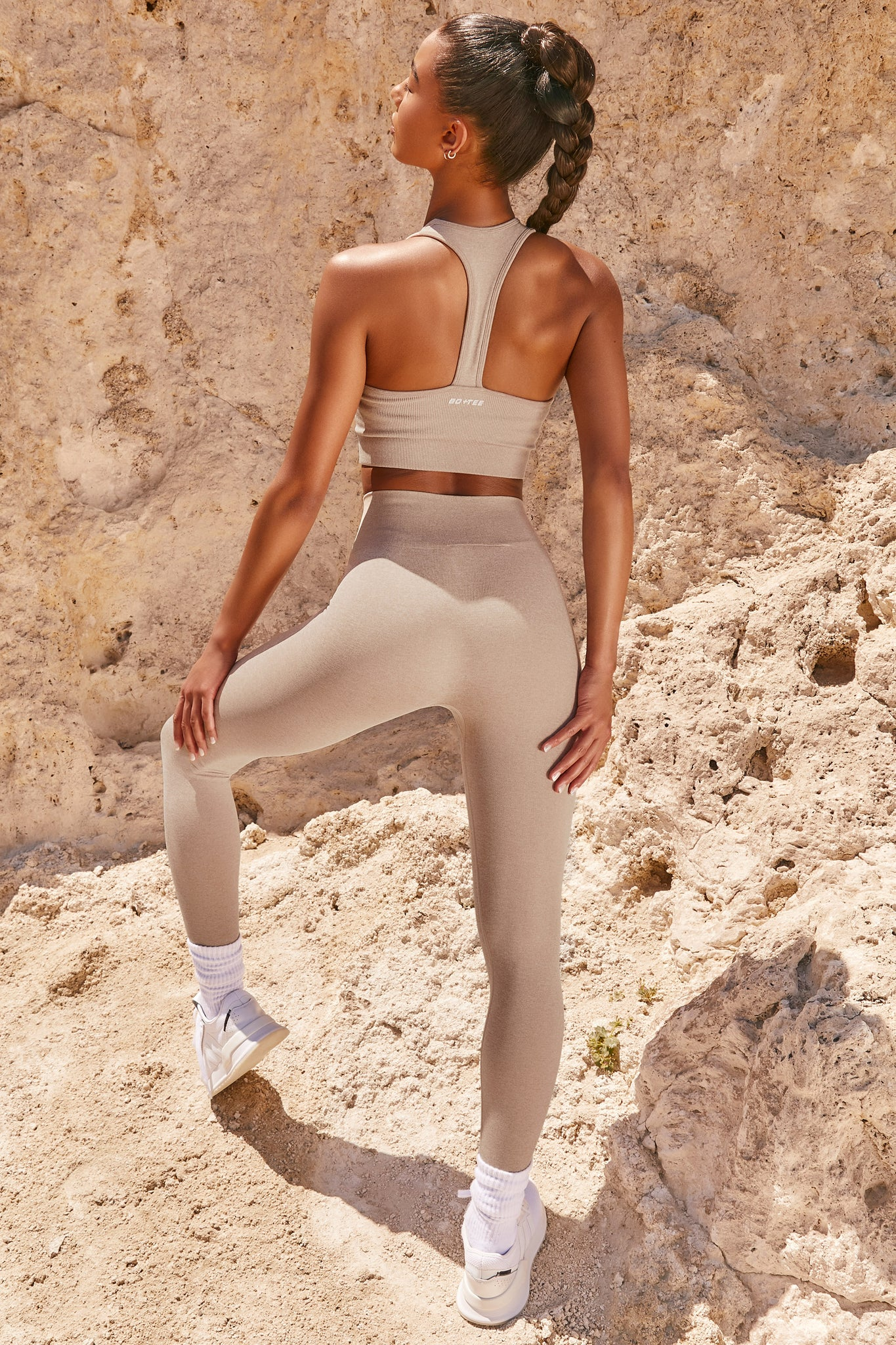 Plain sand neck sleeveless crop top with ribbed underband and racer back. Image 3 of 6.