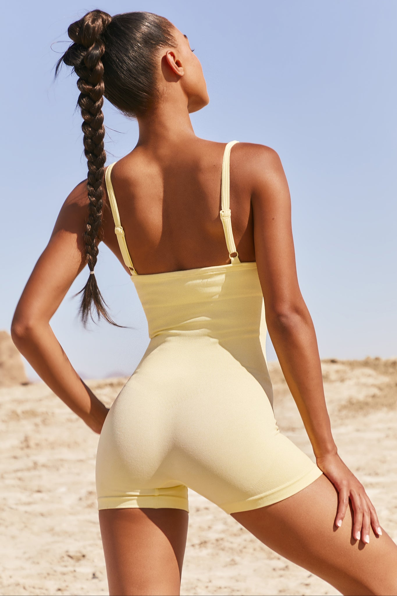 Plain lemon seamless unitard with plunge neck and adjustable straps. Image 3 of 6.