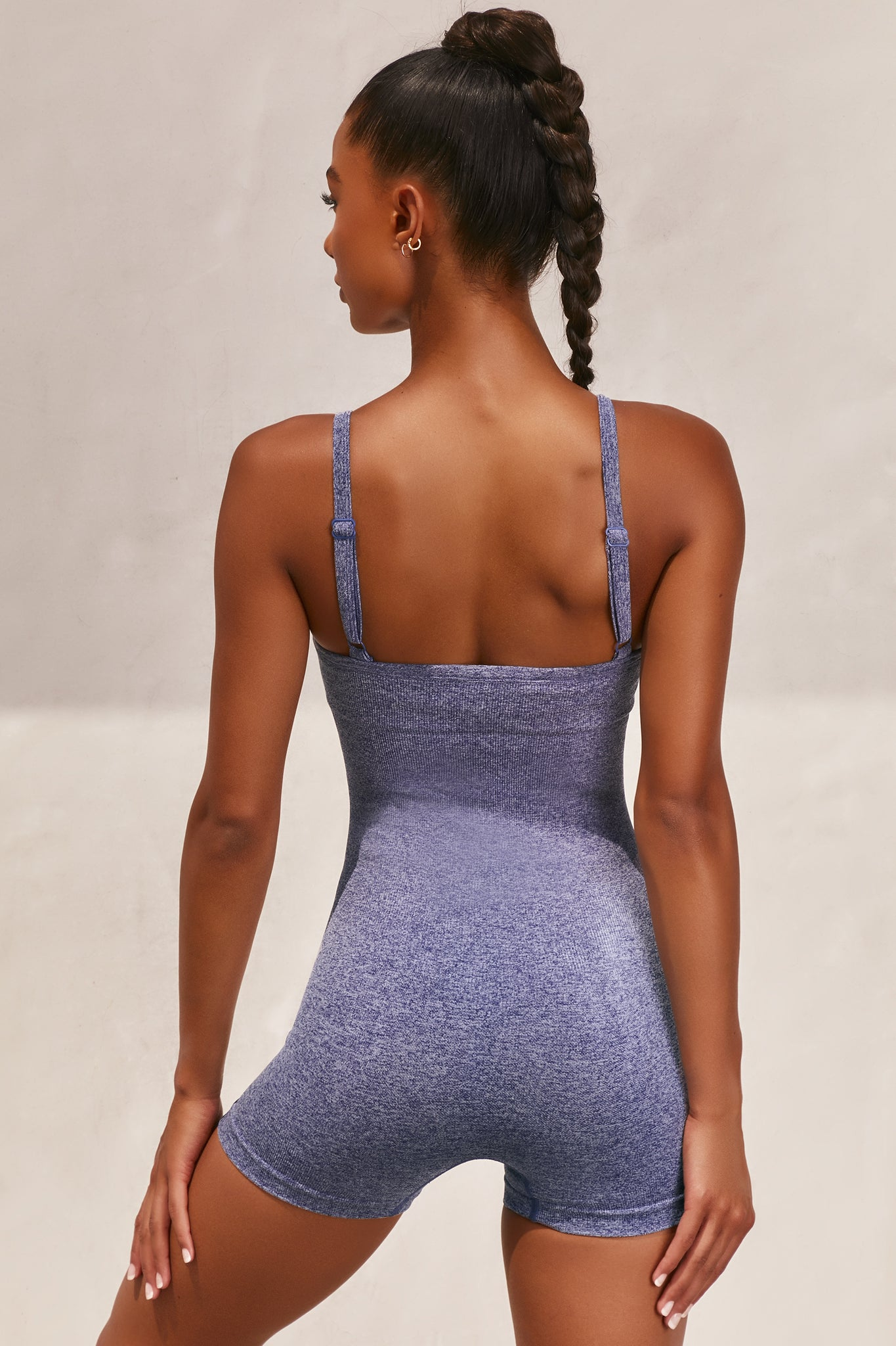 Plain navy marl seamless unitard with plunge neck and adjustable straps. Image 3 of 6.