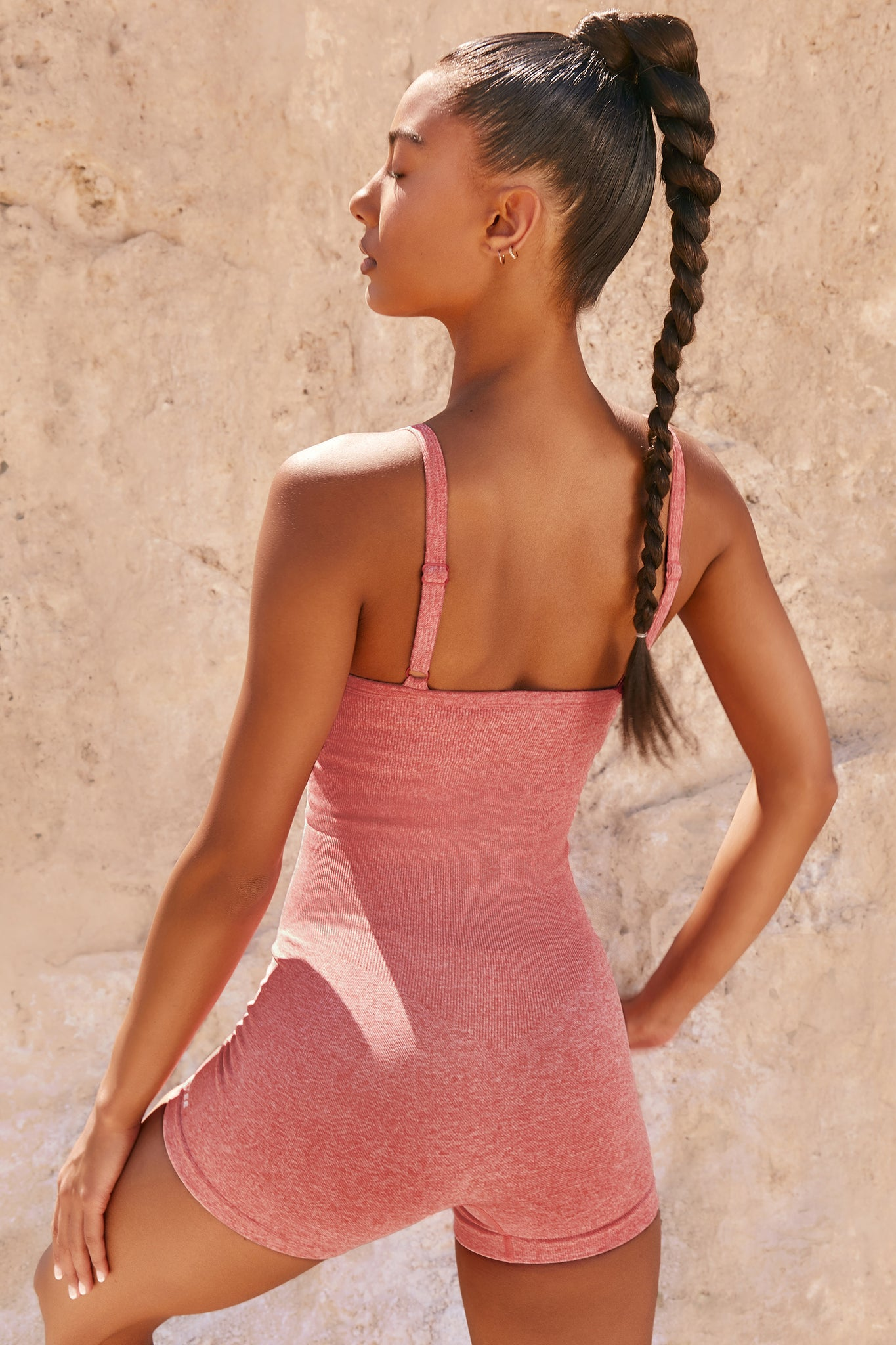 Plain coral marl seamless unitard with plunge neck and adjustable straps. Image 3 of 6.