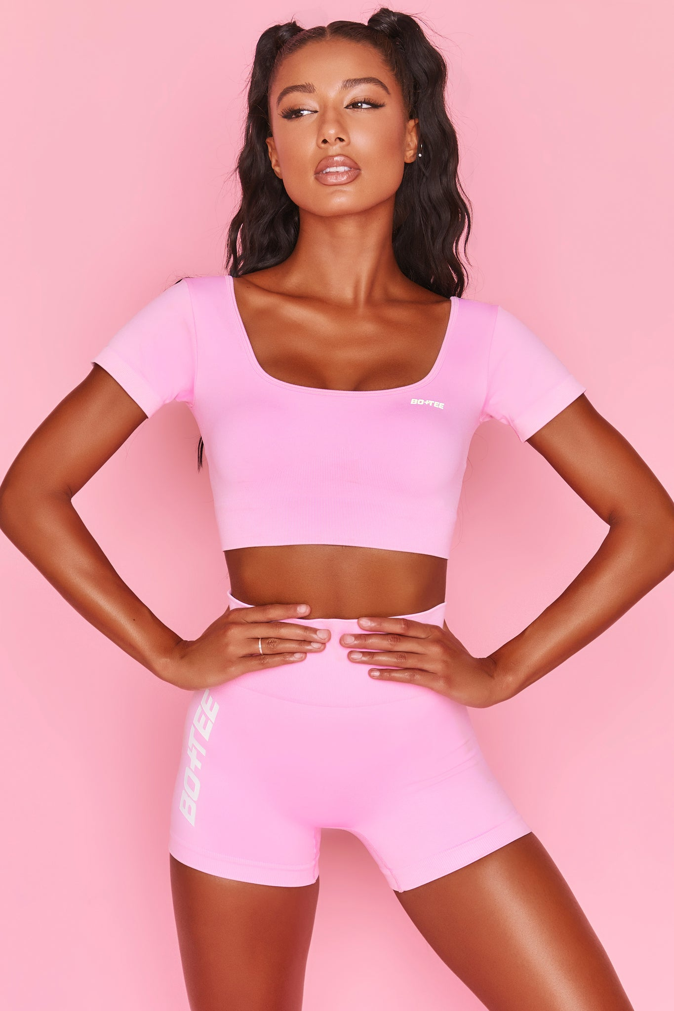Pink scoop neck crop top with short sleeves and ribbed underband. Image 6 of 6.