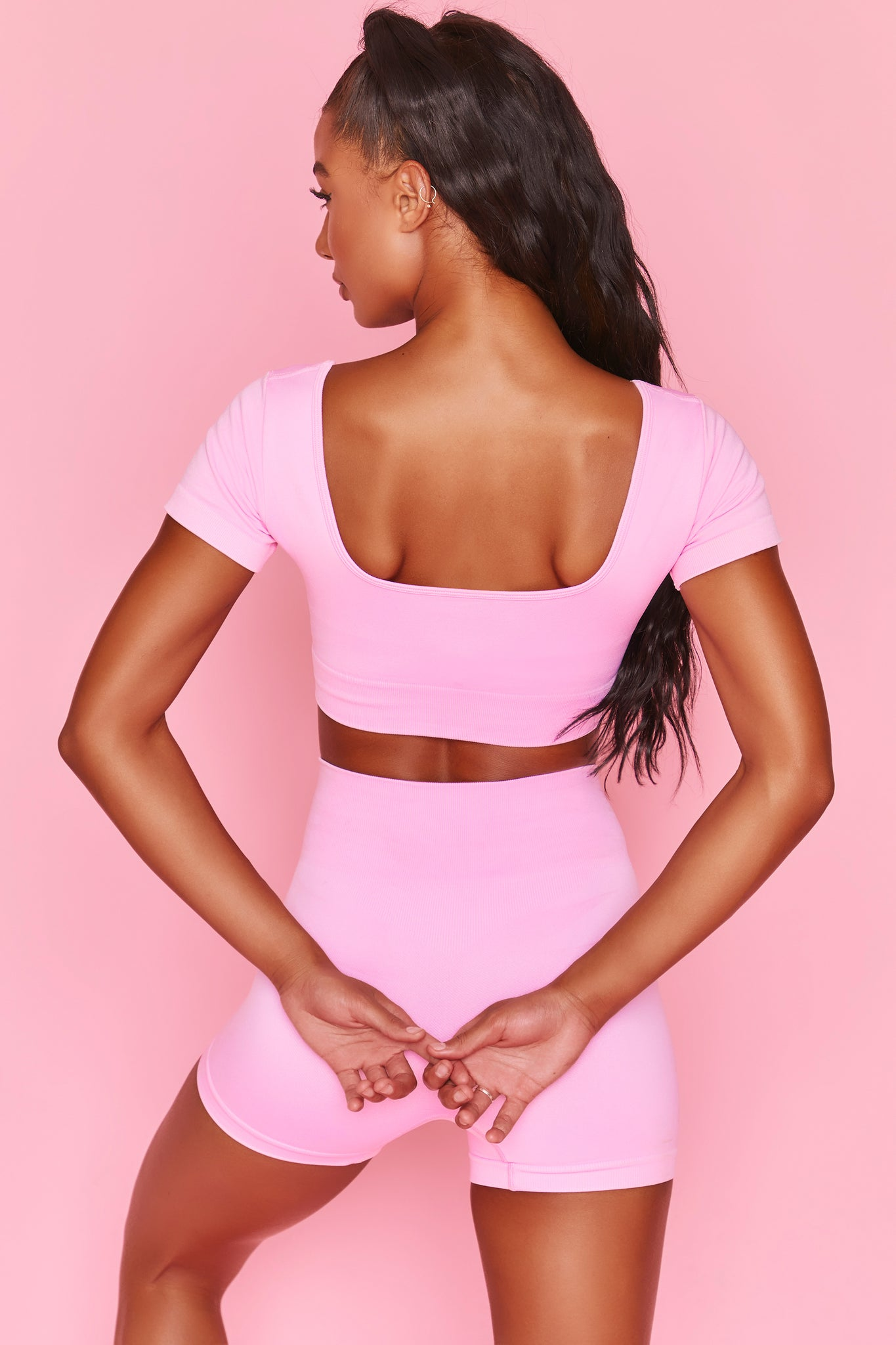 Pink scoop back crop top with short sleeves and ribbed underband. Image 3 of 6.