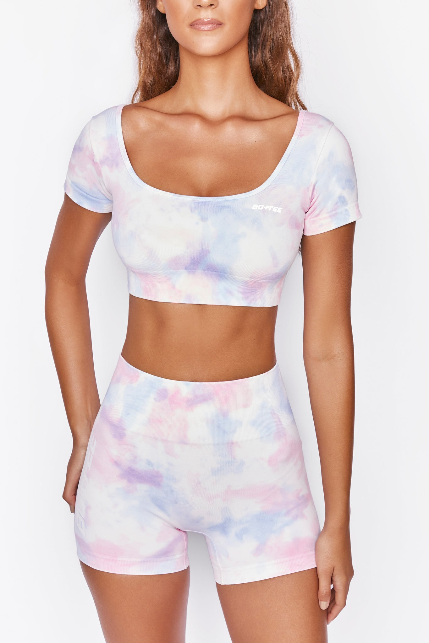 Tie Dye scoop neck crop top with short sleeves and ribbed underband. Image 6 of 6.
