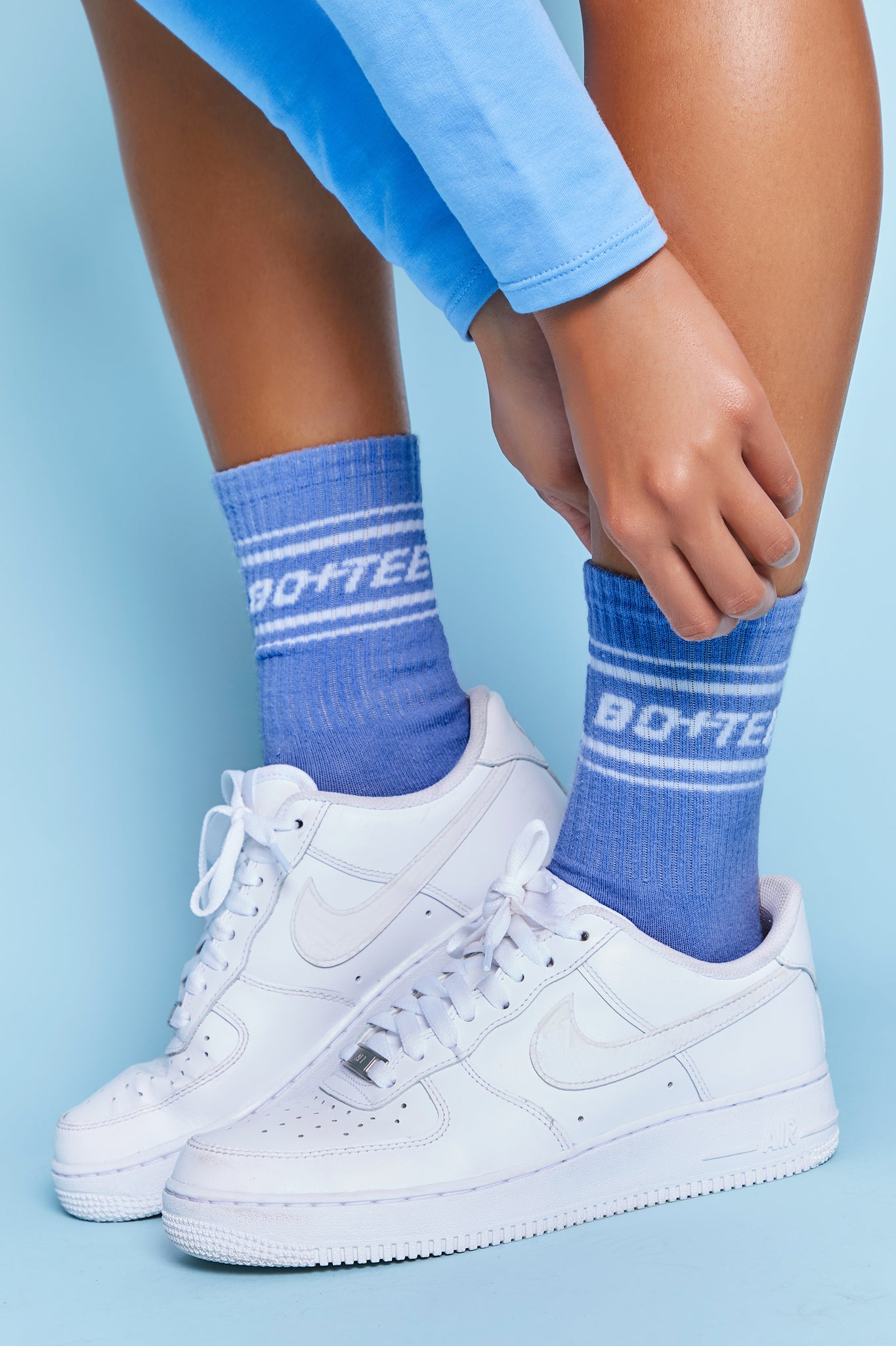 Blue ribbed ankle socks with Bo+Tee logo and stripe detailing. Image 1 of 6.