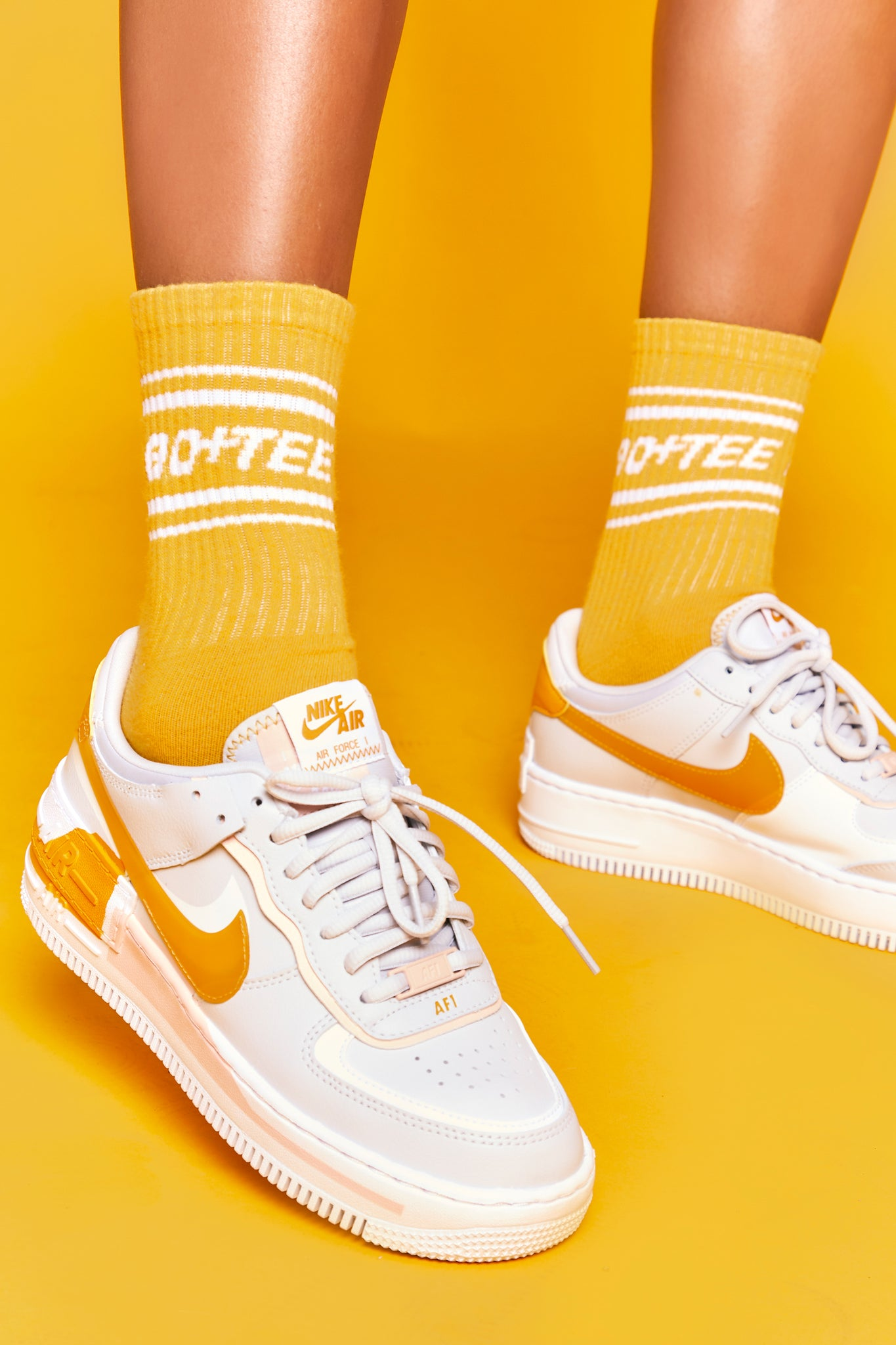 Orange ribbed ankle socks with Bo+Tee logo and stripe detailing. Image 3 of 6.