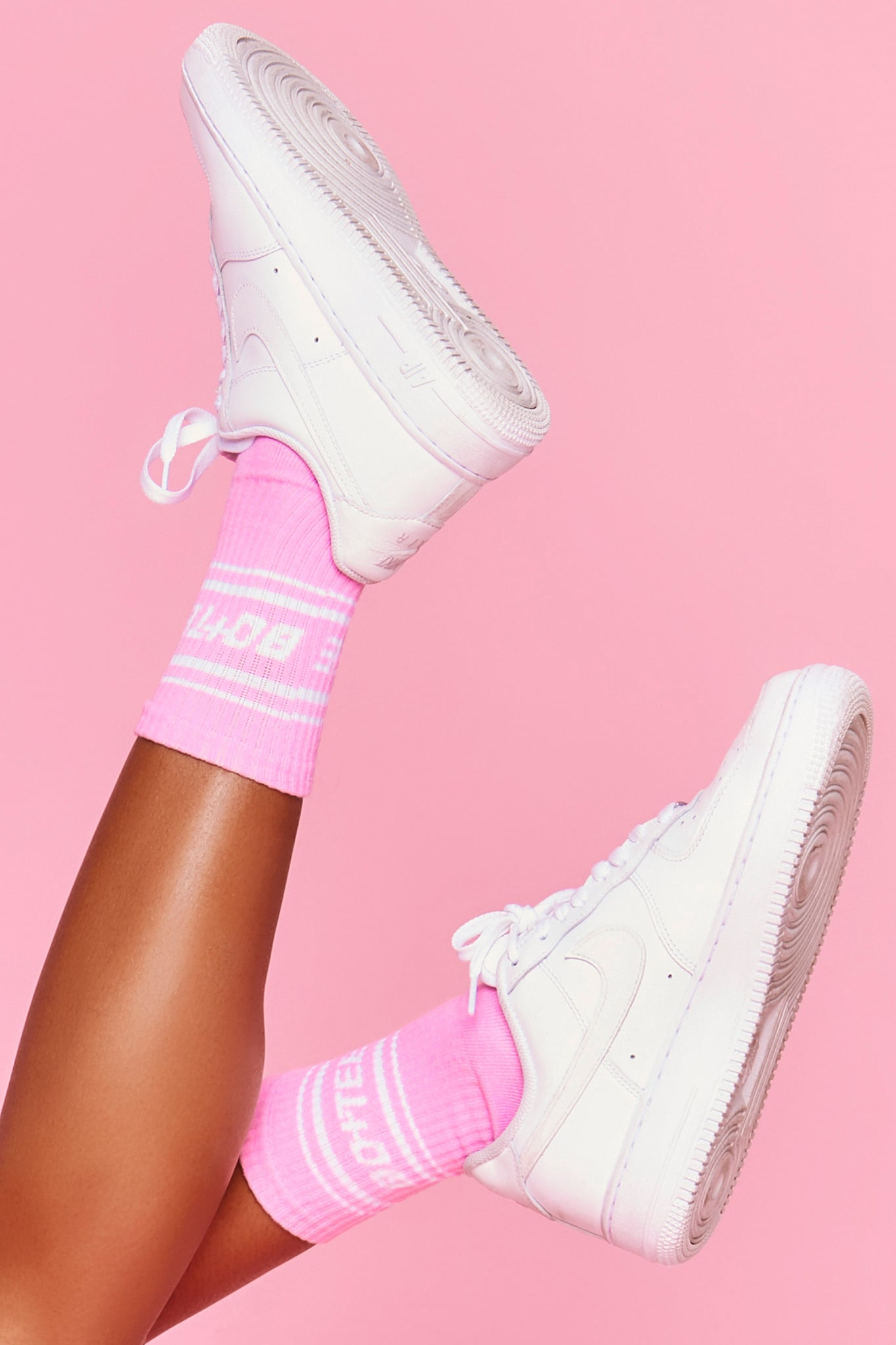 Pink ribbed ankle socks with Bo+Tee logo and stripe detailing. Image 1 of 6.