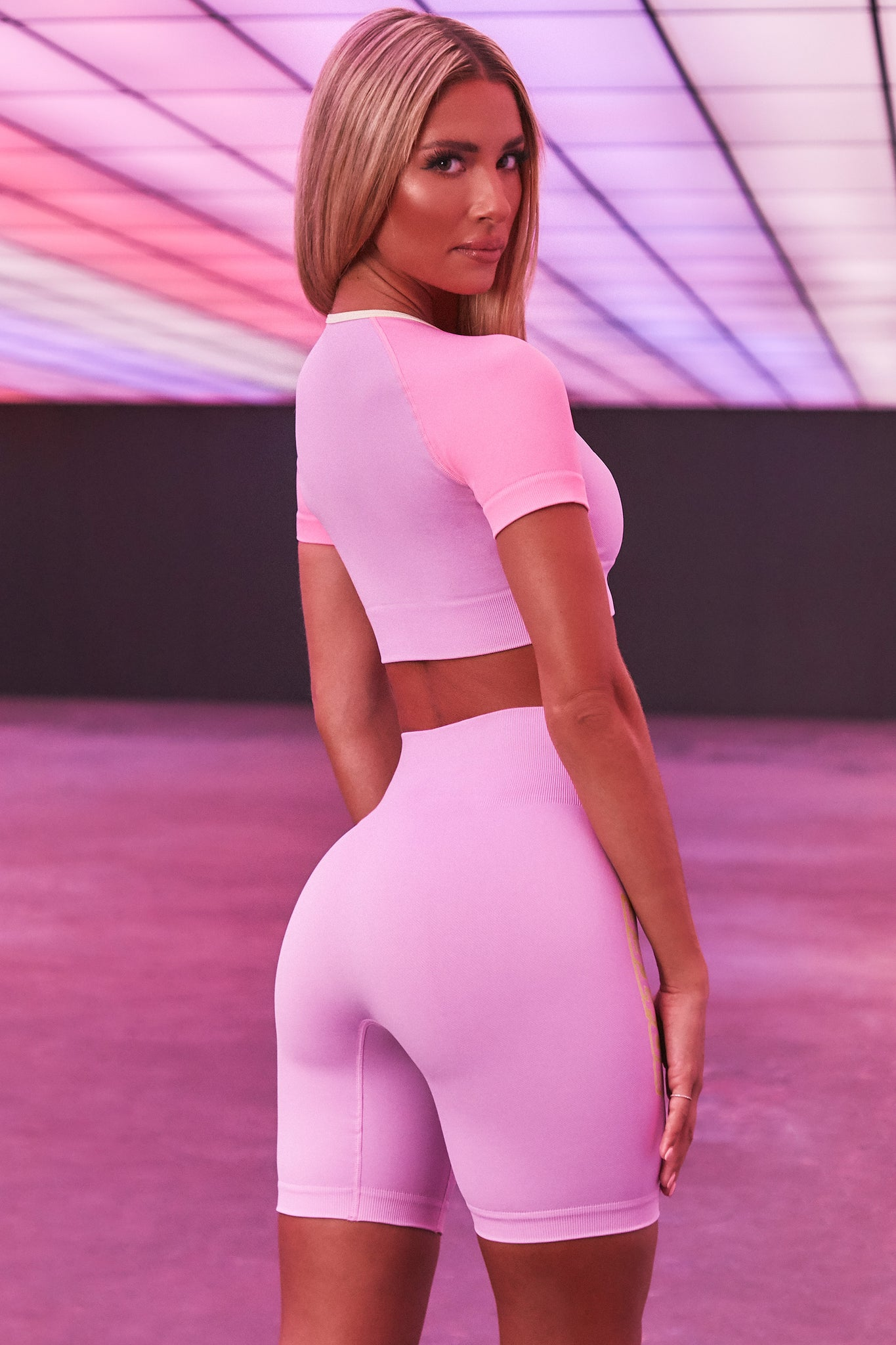 Lilac seamless high waisted cycling shorts with 3D branding down the leg. Image 3 of 6.